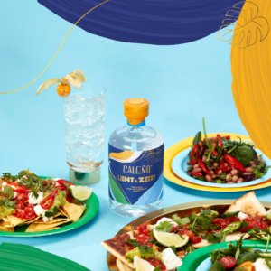 Caleno light & zesty bottle with plates of food