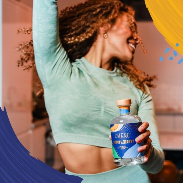 Lady dancing holding a Caleno Light & Zesty Bottle