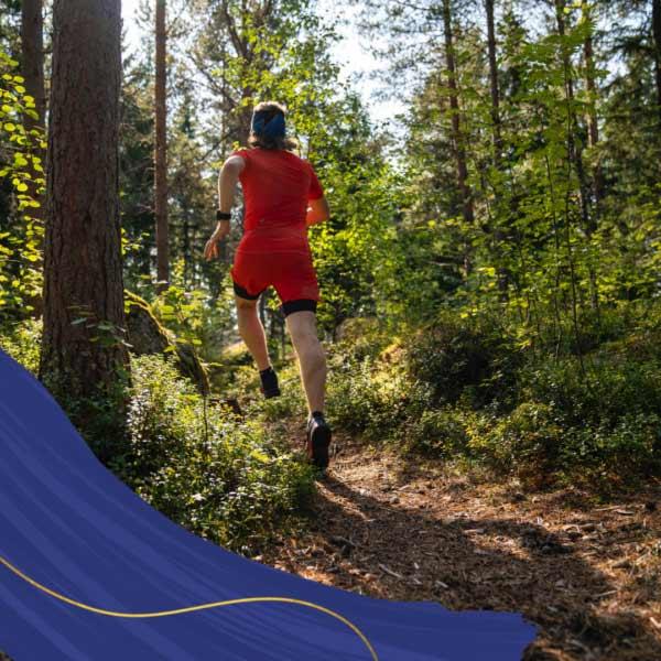 Male running through forest.