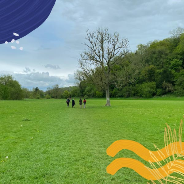 Four people in a distance in a fields